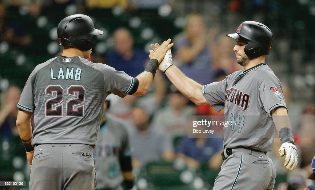 Paul Goldschmidt #44 of the Arizona Diamondbacks high fives Jake Lamb #22 after hitting a home run in the eighth inning at Minute Maid Park on August 16, 2017 in Houston, Texas.