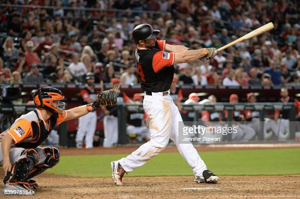 Paul Goldschmidt of the Arizona Diamondbacks hits a three run homer in the eighth inning against the San Francisco Giants at Chase Field on August 27...