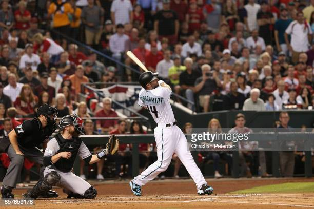 Paul Goldschmidt of the Arizona Diamondbacks hits a threerun home run during the bottom of the first inning of the National League Wild Card game...