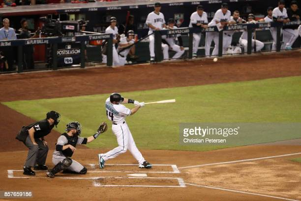 Paul Goldschmidt of the Arizona Diamondbacks hits a threerun homerun during the bottom of the first inning of the National League Wild Card game...