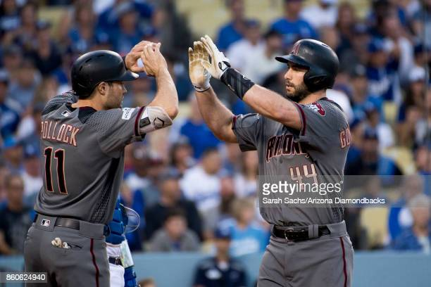 Paul Goldschmidt of the Arizona Diamondbacks is congratulated by AJ Pollock after hitting a two run home run in the top of the first inning during...