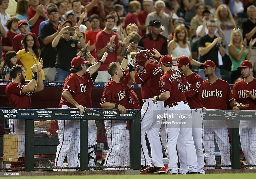 <a gi-track='captionPersonalityLinkClicked' href=/galleries/search?phrase=Paul+Goldschmidt&family=editorial&specificpeople=7511120 ng-click='$event.stopPropagation()'>Paul Goldschmidt</a> #44 of the Arizona Diamondbacks is congratulated by fans and teammates after being removed in the eighth inning of the MLB game against the Washington Nationals at Chase Field on September 29, 2013 in Phoenix, Arizona. The Diamondbacks defeated the Nationals 3-2.