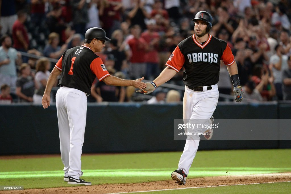 Paul Goldschmidt #44 of the Arizona Diamondbacks is congratulated by third base coach Tony Perezchica #1 after hitting a three run homer in the eighth inning against the San Francisco Giants at Chase Field on August 27, 2017 in Phoenix, Arizona.