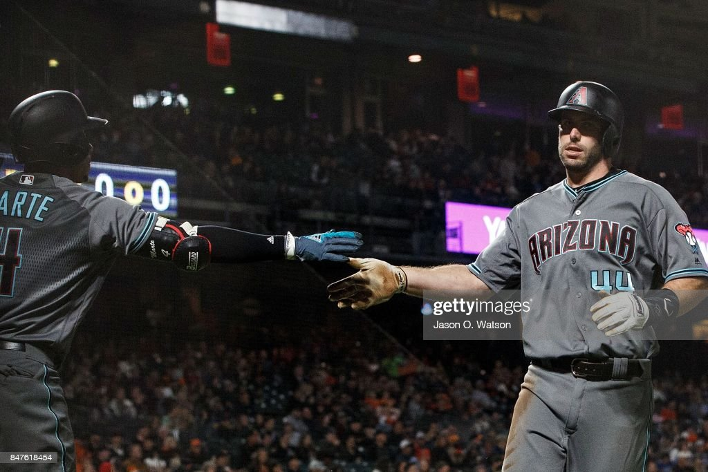 Paul Goldschmidt #44 of the Arizona Diamondbacks is congratulated by Ketel Marte #4 after scoring a run against the San Francisco Giants during the second inning at AT&T Park on September 15, 2017 in San Francisco, California.