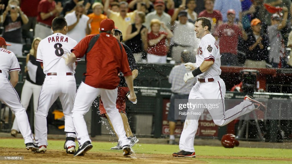 Paul Goldschmidt of the Arizona Diamondbacks is dowsed with water by teammates as he approaches home plate following his gamewinning walk off home...