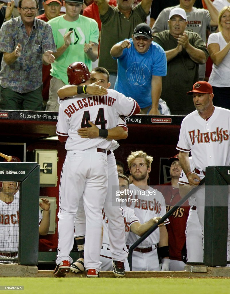 <a gi-track='captionPersonalityLinkClicked' href=/galleries/search?phrase=Paul+Goldschmidt&family=editorial&specificpeople=7511120 ng-click='$event.stopPropagation()'>Paul Goldschmidt</a> #44 of the Arizona Diamondbacks is embraced by teammate <a gi-track='captionPersonalityLinkClicked' href=/galleries/search?phrase=Gerardo+Parra&family=editorial&specificpeople=4959447 ng-click='$event.stopPropagation()'>Gerardo Parra</a> #8 after his game-tying solo home run against the Baltimore Orioles during the bottom of the ninth inning of a MLB game at Chase Field on August 13, 2013 in Phoenix, Arizona.