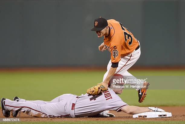 Paul Goldschmidt of the Arizona Diamondbacks is forced out at second base by Kelby Tomlinson of the San Francisco Giants in the top of the first...