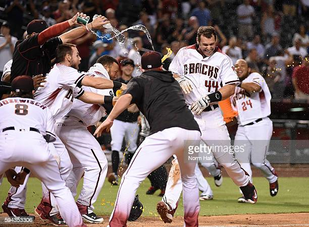 Paul Goldschmidt of the Arizona Diamondbacks is showered with water by teammates at home plate after hitting a walk off home run in the ninth inning...