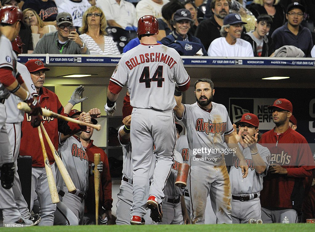 <a gi-track='captionPersonalityLinkClicked' href=/galleries/search?phrase=Paul+Goldschmidt&family=editorial&specificpeople=7511120 ng-click='$event.stopPropagation()'>Paul Goldschmidt</a> #44 of the Arizona Diamondbacks is welcomed into the dugout after hitting a solo home run during the sixth inning of a baseball game against the San Diego Padres at Petco Park on September 24, 2013 in San Diego, California.