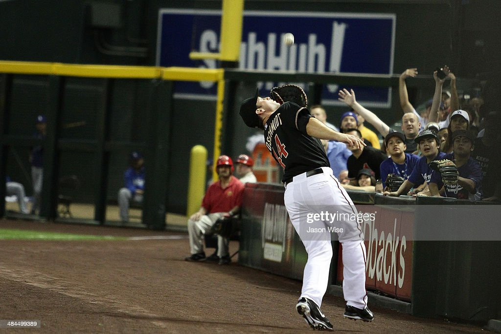<a gi-track='captionPersonalityLinkClicked' href=/galleries/search?phrase=Paul+Goldschmidt&family=editorial&specificpeople=7511120 ng-click='$event.stopPropagation()'>Paul Goldschmidt</a> #44 of the Arizona Diamondbacks makes a catch in foul territory against the Los Angeles Dodgers at Chase Field on April 12, 2014 in Phoenix, Arizona.