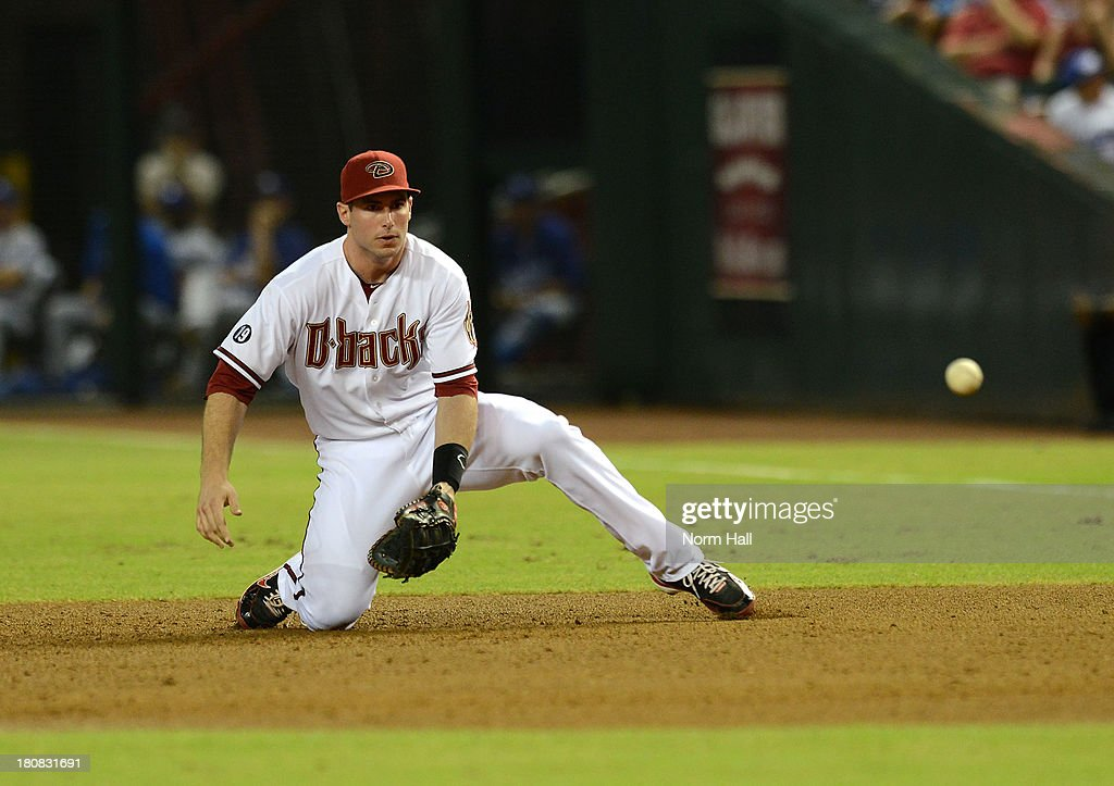 <a gi-track='captionPersonalityLinkClicked' href=/galleries/search?phrase=Paul+Goldschmidt&family=editorial&specificpeople=7511120 ng-click='$event.stopPropagation()'>Paul Goldschmidt</a> #44 of the Arizona Diamondbacks makes a play on a ground ball against the Los Angeles Dodgers at Chase Field on September 16, 2013 in Phoenix, Arizona.
