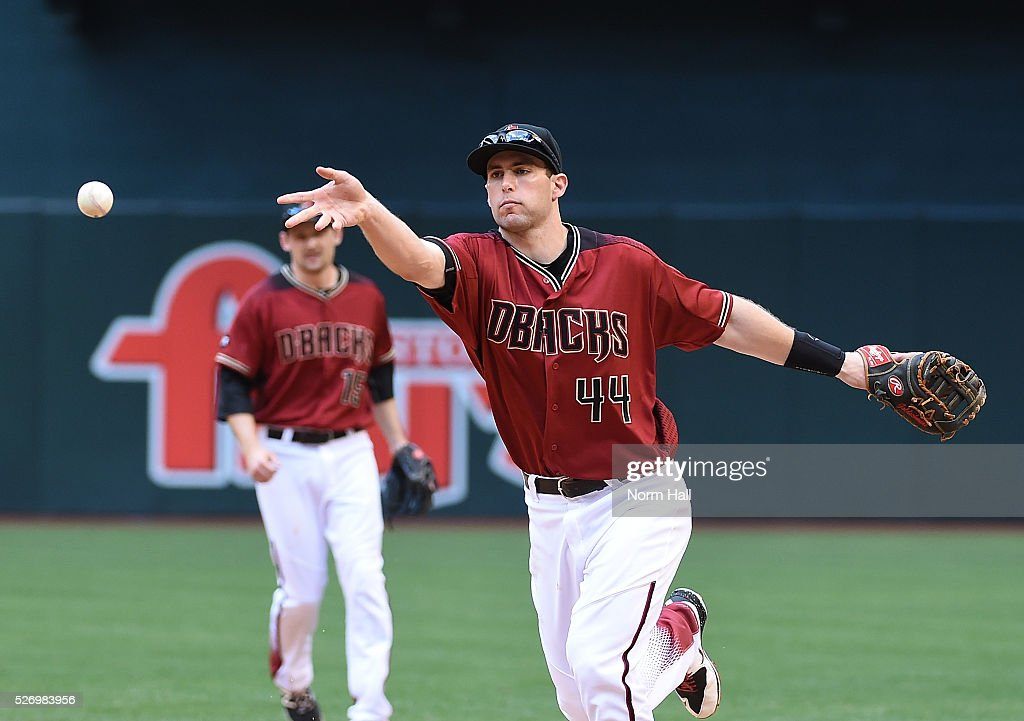 Paul Goldschmidt #44 of the Arizona Diamondbacks makes an underhand toss to teammate Tyler Clippard #19 after making a play on a ground ball by Tony Wolters #14 of the Colorado Rockies who was forced out at first base at Chase Field on May 01, 2016 in Phoenix, Arizona. Rockies won 6-3.