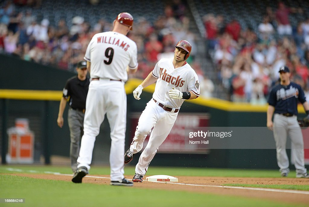 <a gi-track='captionPersonalityLinkClicked' href=/galleries/search?phrase=Paul+Goldschmidt&family=editorial&specificpeople=7511120 ng-click='$event.stopPropagation()'>Paul Goldschmidt</a> #44 of the Arizona Diamondbacks rounds third base after hitting a first inning home run against the Atlanta Braves at Chase Field on May 13, 2013 in Phoenix, Arizona.