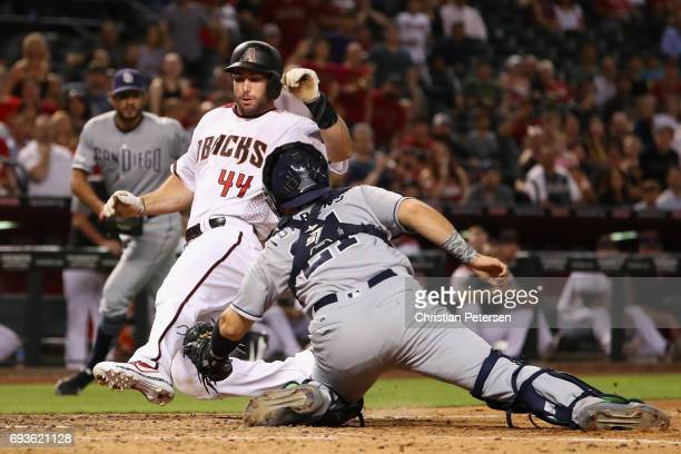 Paul Goldschmidt of the Arizona Diamondbacks safely slides into home plate to score a run past catcher Luis Torrens of the San Diego Padres during...
