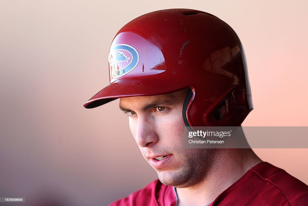 <a gi-track='captionPersonalityLinkClicked' href=/galleries/search?phrase=Paul+Goldschmidt&family=editorial&specificpeople=7511120 ng-click='$event.stopPropagation()'>Paul Goldschmidt</a> #44 of the Arizona Diamondbacks stands in the dugout during the spring training game against the Kansas City Royals at Surprise Stadium on February 25, 2013 in Surprise, Arizona.