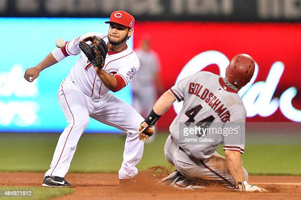 Paul Goldschmidt of the Arizona Diamondbacks steals second base in the fifth inning as Eugenio Suarez of the Cincinnati Reds takes the throw at Great...