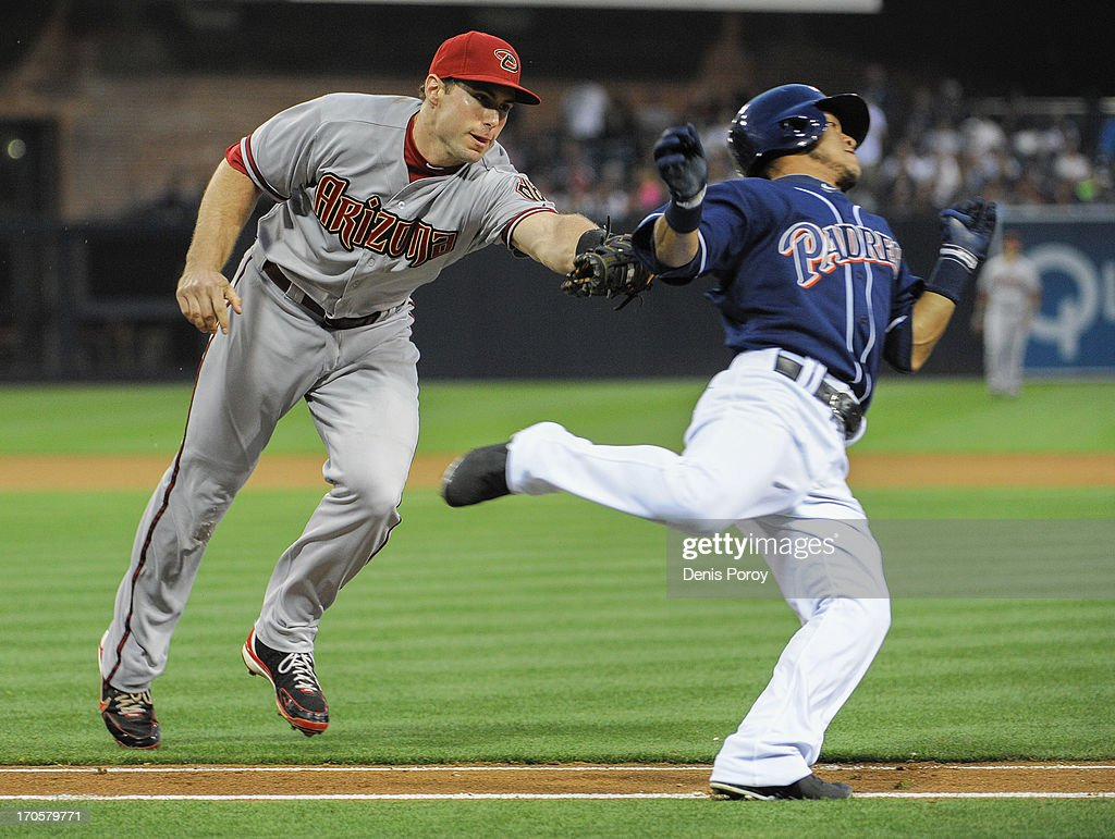 <a gi-track='captionPersonalityLinkClicked' href=/galleries/search?phrase=Paul+Goldschmidt&family=editorial&specificpeople=7511120 ng-click='$event.stopPropagation()'>Paul Goldschmidt</a> #44 of the Arizona Diamondbacks tags out <a gi-track='captionPersonalityLinkClicked' href=/galleries/search?phrase=Alexi+Amarista&family=editorial&specificpeople=6795464 ng-click='$event.stopPropagation()'>Alexi Amarista</a> #5 of the San Diego Padres on the first base line during the third inning of a baseball game at Petco Park on June 14, 2013 in San Diego, California.