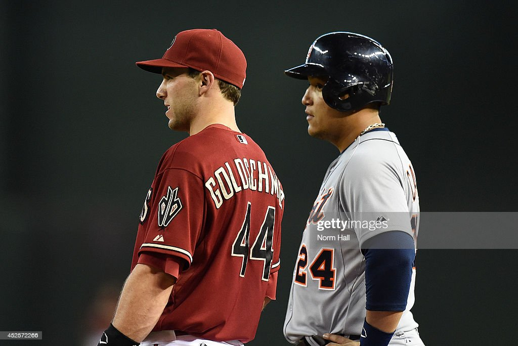 Paul Goldschmidt #44 of the Arizona Diamondbacks talks with Miguel Cabrera #24 of the Detroit Tigers between batters at Chase Field on July 23, 2014 in Phoenix, Arizona.
