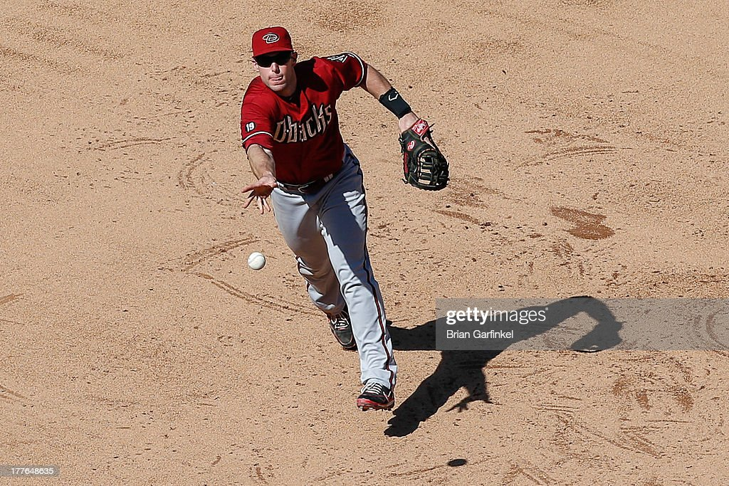 <a gi-track='captionPersonalityLinkClicked' href=/galleries/search?phrase=Paul+Goldschmidt&family=editorial&specificpeople=7511120 ng-click='$event.stopPropagation()'>Paul Goldschmidt</a> #44 of the Arizona Diamondbacks tosses the ball to first base to close out the sixth inning of the game against the Philadelphia Phillies at Citizens Bank Park on August 25, 2013 in Philadelphia, Pennsylvania. The Phillies won 9-5.