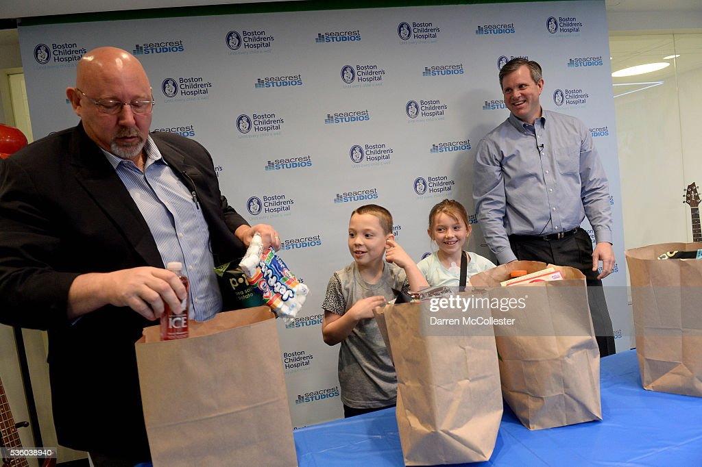 Paul Gossett, President, Shaw's Supermarkets, and Russ Greenlaw, Director Of Operations, Star Market, compete in a grocery bagging race with kids at the Shaw's & Star Market Give A Smile Kick-Off At Boston Children's Hospital May 31, 2016 in Boston, Massachusetts.