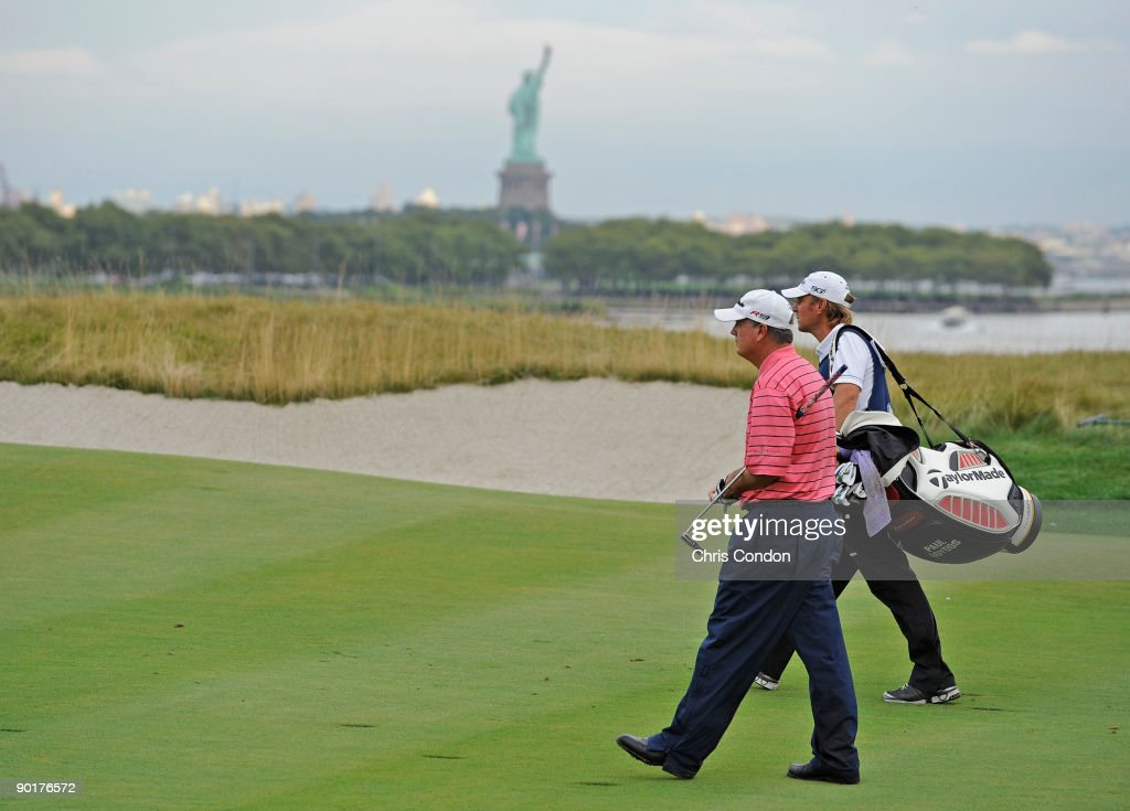 Paul Goydos and his caddie walk up the 18th fairway during the third round of The Barclays at Liberty National Golf Club on August 29 2009 in Jersey...
