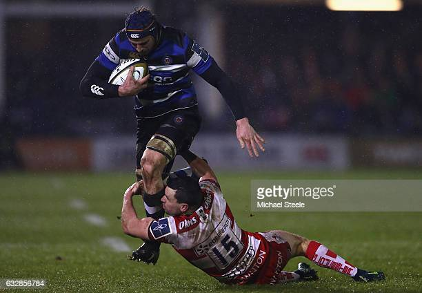 Paul Grant of Bath is tackled by Tom Marshall of Gloucester during the Anglo Welsh Cup match between Bath Rugby and Gloucester Rugby at the...