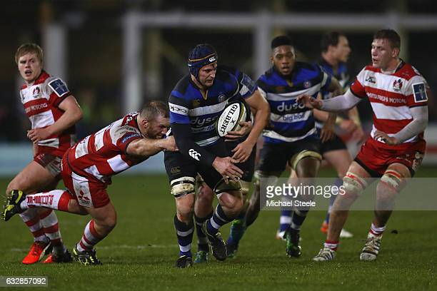 Paul Grant of Bath is tackled by Yann Thomas of Gloucester during the Anglo Welsh Cup match between Bath Rugby and Gloucester Rugby at the Recreation...