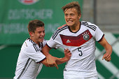 Paul Grauschopf of Germany celebrates scoring the second team goal with his team mate Mats Koehlert who scores the first team goal during the KOMM...