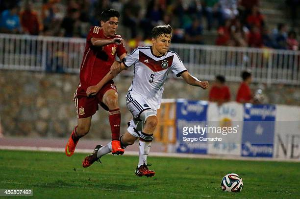 Paul Grauschopf of Germany challenges Francisco J Villalba Rodrigo of Spain during the international friendly match between U17 Spain and U17 Germany...