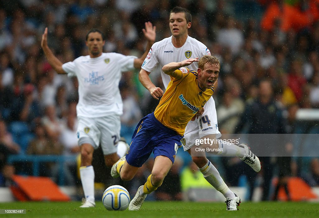 Paul Green of Derby County is fouled by Jonathan Howson of Leeds United during the npower Championship match between Leeds United and Derby County at Elland Road on August 7, 2010 in Leeds, England.