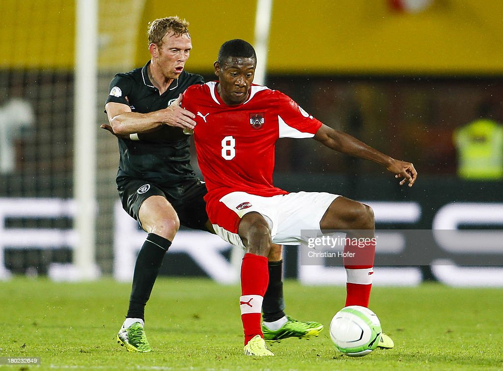 Paul Green of Ireland (L) challenges David Alaba of Austria during the FIFA World Cup 2014 Group C qualification match between Austria and the Republic of Ireland at the Ernst Happel Stadium on September 10, 2013 in Vienna, Austria.