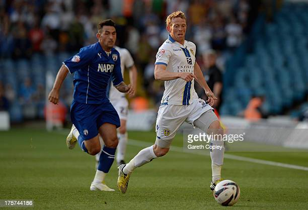 Paul Green of Leeds gets past Gary Roberts of Chesterfield during the Capital One Cup First Round match between Leeds United and Chesterfield at...