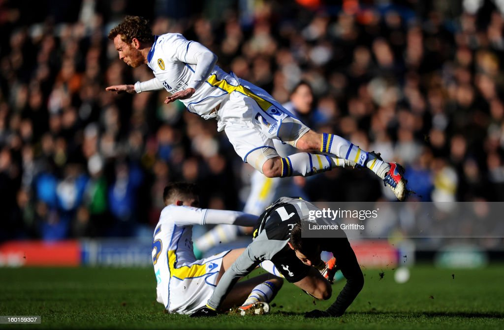 Paul Green of Leeds hurdles the grounded Gareth Bale of Spurs during the FA Cup with Budweiser Fourth Round match between Leeds United and Tottenham Hotspur at Elland Road on January 27, 2013 in Leeds, England.