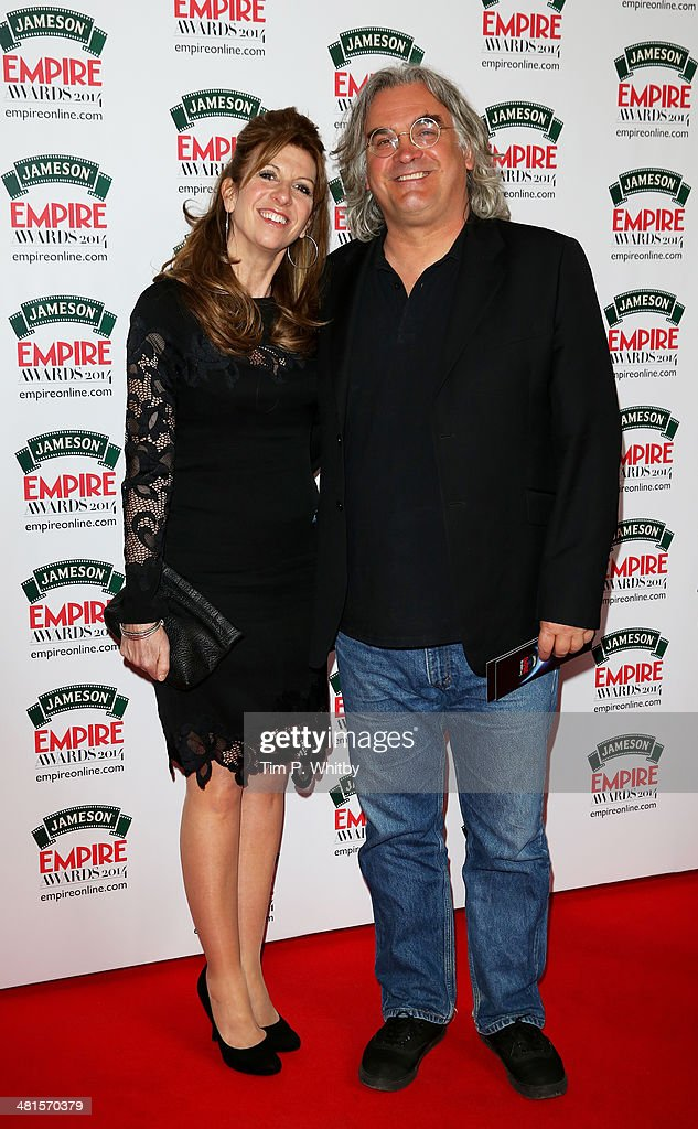 Paul Greengrass and guest attend the Jameson Empire Awards 2014 at the Grosvenor House Hotel on March 30, 2014 in London, England. Regarded as a relaxed end to the awards show season, the Jameson Empire Awards celebrate the film industry's success stories of the year with winners being voted for entirely by members of the public. Visit empireonline.com/awards2014 for more information.