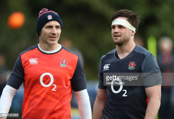 Paul Gustard the England defence coach speaks with Jack Clifford during the England training session at Pennyhill Park on February 7 2017 in Bagshot...