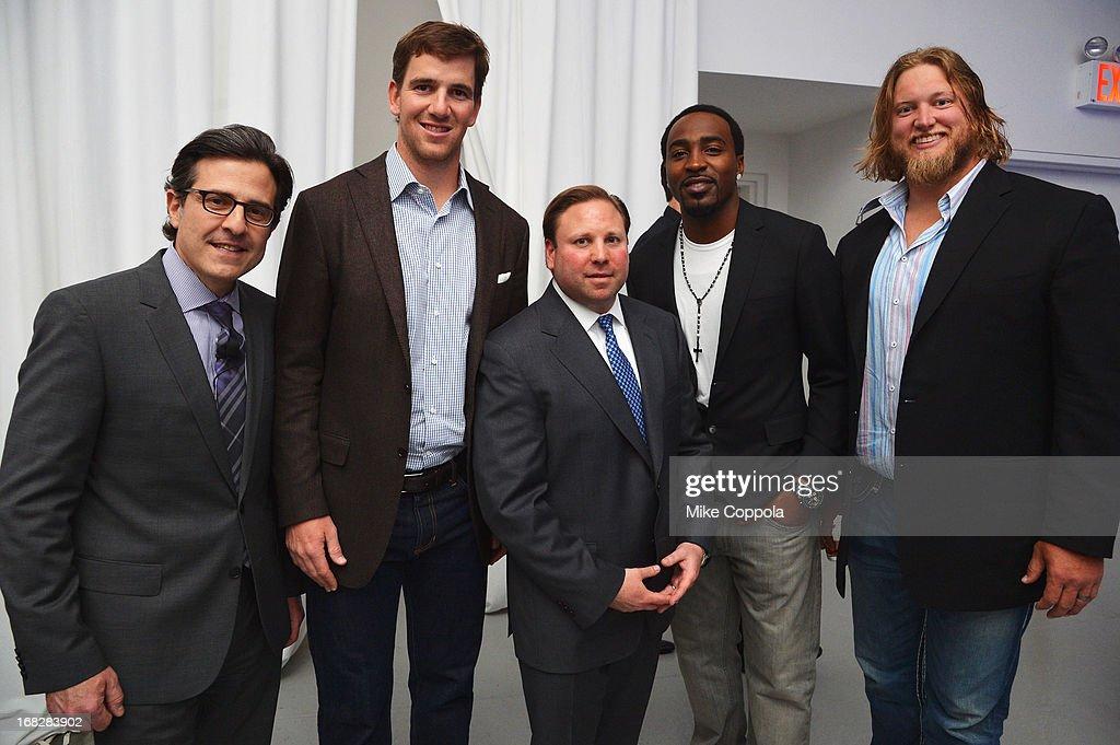 Paul Guyardo, Eli Manning, Keith Kazerman, Hakeem Nicks and Nick Mangold attend DIRECTV's 2013 National Ad Sales Upfront on May 7, 2013 in New York City.