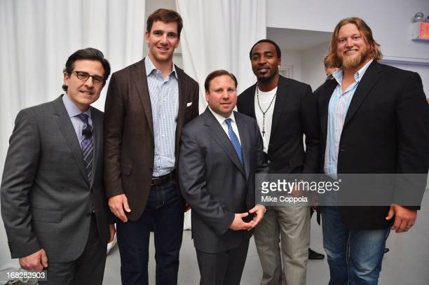 Paul Guyardo Eli Manning Keith Kazerman Hakeem Nicks and Nick Mangold attend DIRECTV's 2013 National Ad Sales Upfront on May 7 2013 in New York City