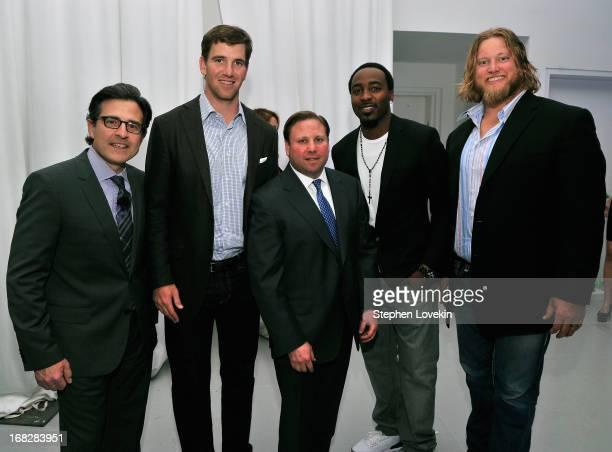 Paul Guyardo Eli Manning Keith Kazerman Hakeem Nicks and Nick Mangold attend DIRECTV's 2013 National Ad Sales Upfront on May 7 2013 in New York City