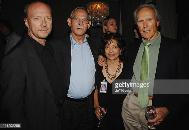 Paul Haggis poses with Lanny Davis and Remy Davis the parents of US Army Spc Richard Davis and Clint Eastwood at the premiere of 'In The Valley Of...