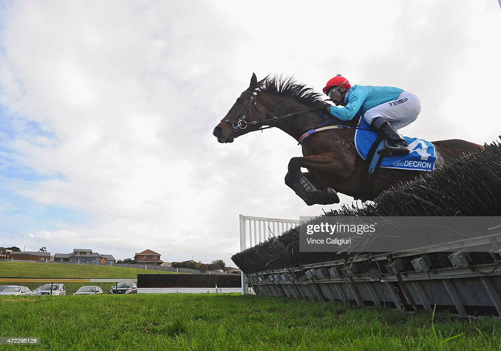 Paul Hamblin riding Stand To Gain (r) jumping hurdle in the first lap before winning Race 6, the Sovereign Resort Galleywood during Galleywood Day at Warrnambool Racing Club on May 6, 2015 in Warrnambool, Australia.