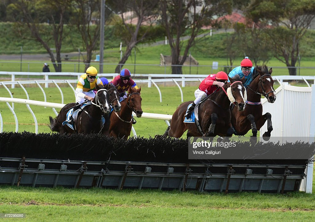 Paul Hamblin riding Stand To Gain (r) jumps the last jump to defeat Darryl Horner (jnr) riding Zuhayr in Race 6, the Sovereign Resort Galleywood during Galleywood Day at Warrnambool Racing Club on May 6, 2015 in Warrnambool, Australia.