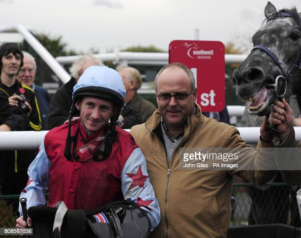 Paul Hanagan and Diggeratt with their trainer Richard Fahey after their win in the Bet Multiples Betdaq Claiming Stakes at Southwell Racecourse Newark