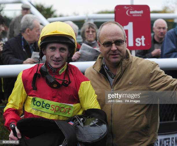 Paul Hanagan and trainer Richard Fahey after victory on Sloop Johnb in the Bet Asian Handicaps Betdaq Handicap at Southwell Racecourse Newark