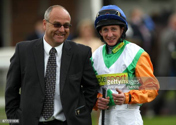 Paul Hanagan jockey of Barefoot Lady chats to trainer Richard Fahey prior to the start of The Tattersalls Musidora Stakes