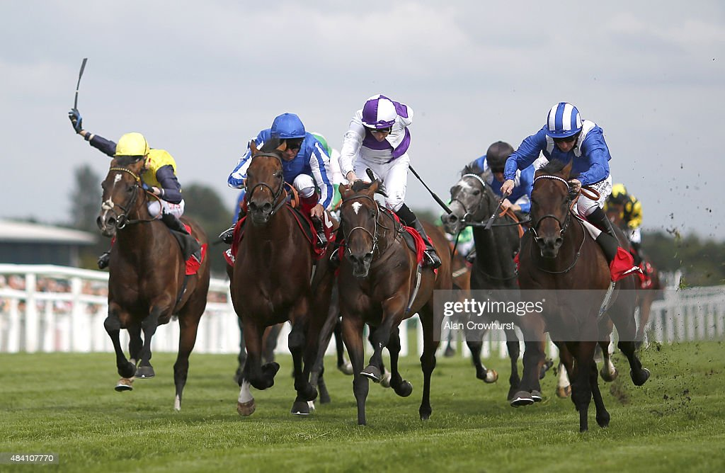 Paul Hanagan riding Adaay (R) win The Betfred Hungerford Stakes at Newbury racecourse on August 15, 2015 in Newbury, England.