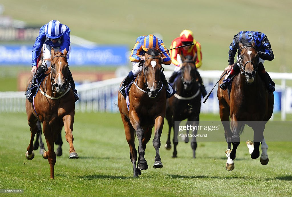 Paul Hanagan riding Anjaal (L, blue) win The Portland Place Properties July Stakes at Newmarket racecourse on July 11, 2013 in Newmarket, England.