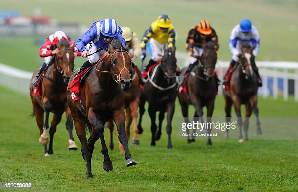 Paul Hanagan riding Estidhkaar win The 666Bet Superlative Stakes at Newmarket racecourse on July 12 2014 in Newmarket England