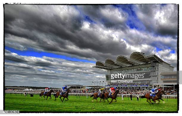 Paul Hanagan riding Etaab win The Nayef Rosemary Stakes at Newmarket racecourse on September 26 2014 in Newmarket England