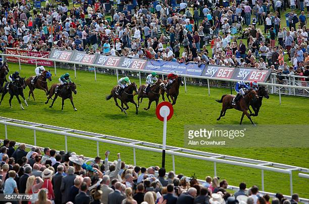 Paul Hanagan riding Fadhayyil win The Sky Bet City Of York Stakes at York racecourse on August 21 2015 in York England