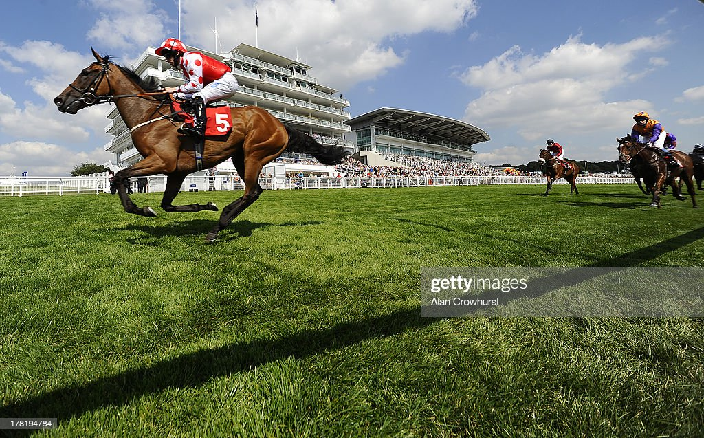 Paul Hanagan riding Imshivalla win The JRA Nursery Handicap Stakes at Epsom racecourse on August 27, 2013 in Epsom, England.